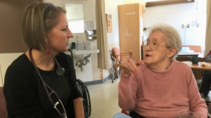 Dr. Rita McCracken, left, with a patient at a nursing home she works at. McCracken wants the province to provide more team-based care for patients. (Providence Health Care)